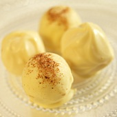 White Chocolate Truffles on Glass Plate
