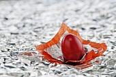 Red egg in silver foil