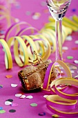 Party streamers and wine cork