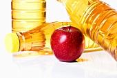 Apple by bottles of apple juice