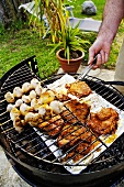 Meat and white mushrooms on barbecue grill