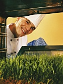 Chef looking at lawn in oven