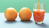 Two grapefruits and pouring grapefruit juice (Stop motion)