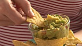 Dipping nacho in guacamole
