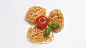 Tagliatelle with tomato and basil leaves
