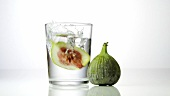 Fig falling into a glass of vodka