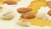 Almonds & cashew nuts on white chocolate couverture with honey