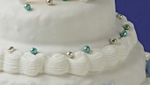 White tiered cake with dragees
