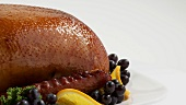 Roast duck with grapes and oranges