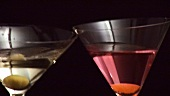 Clinking glasses of Martini and Cosmopolitan