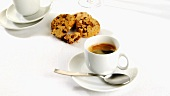 A cup of caffe crema with cookies