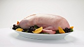 Stuffed duck (ready for roasting) on a platter