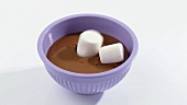Putting marshmallows into melted couverture chocolate