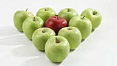 Green apples and one red apple arranged in a triangle