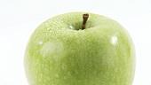 Ein sich drehender grüner Apfel