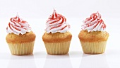 Cupcakes with cream topping and coloured sugar