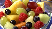 Three bowls of fruit salad