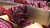 Cutting up red cabbage with a knife