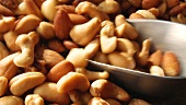 Filling a scoop with mixed nuts