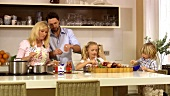 Family preparing evening meal in kitchen
