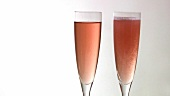 Rosé sparkling wine disappearing from glass