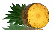 A pineapple showing a cut surface