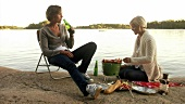 Two women grilling on Blidö (Island, Stockholm Archipelago)