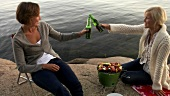 Two women barbecuing & drinking beer (Blidö, Stockholm Archipelago)
