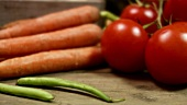 Fresh vegetables (carrots, beans, tomatoes)