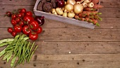 Taking fresh vegetables out of a wooden box