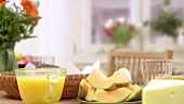 Breakfast table with pieces of melon and orange juice