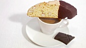 A cup of espresso with chocolate and biscotti