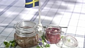 Pickled herrings in jars (Midsummer Festival, Sweden)