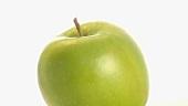Ein sich drehender, grüner Apfel
