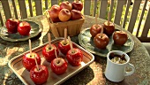 Toffee apples standing on a table out of doors