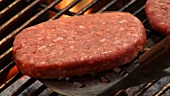 Turning and grilling meat patties for burgers