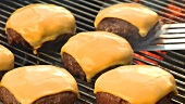 Grilling meat patties for cheeseburgers