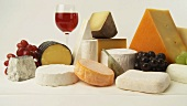 Various cheeses with wine and grapes
