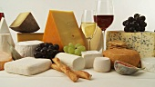 Various cheeses with wine, grapes and savoury biscuits