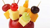 Cheese, fruit and olives on cocktail sticks