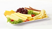 Cheese platter with grapes and salted sticks