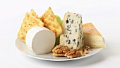 Cheese plate with crackers, grapes and walnuts
