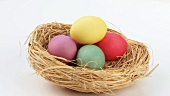Coloured eggs in Easter nest