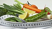 Assorted vegetables with tape measure