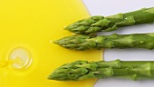 Plating up green asparagus with melted butter