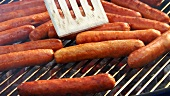 Sausages on a barbecue (for hot dogs)