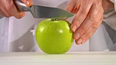 Halving a green apple