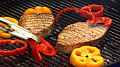 Grilling tuna steaks and pepper slices