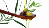 Pouring olive oil over olives