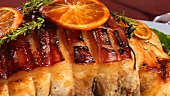 Roast pork with orange slices